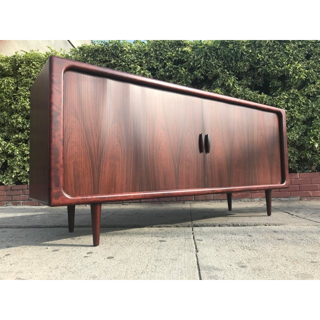 Stunning mid century modern danish rosewood Credenza by Dyrlund.. tambor doors.. small drawers in the center and a lot of...