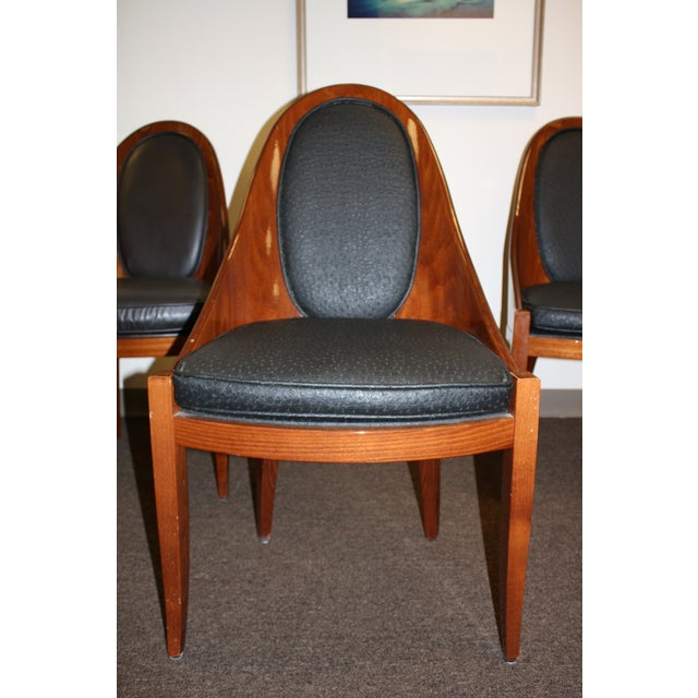 Solid rosewood chairs by Pietro Costantini. Very good condition. A few tiny nicks. In need of new upholstery.