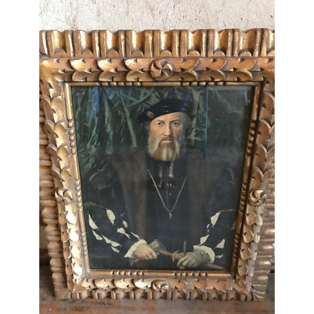 French style ornately carved wood framed mirror. Painted in gold. Please note that the portrait is simply a copy of a...