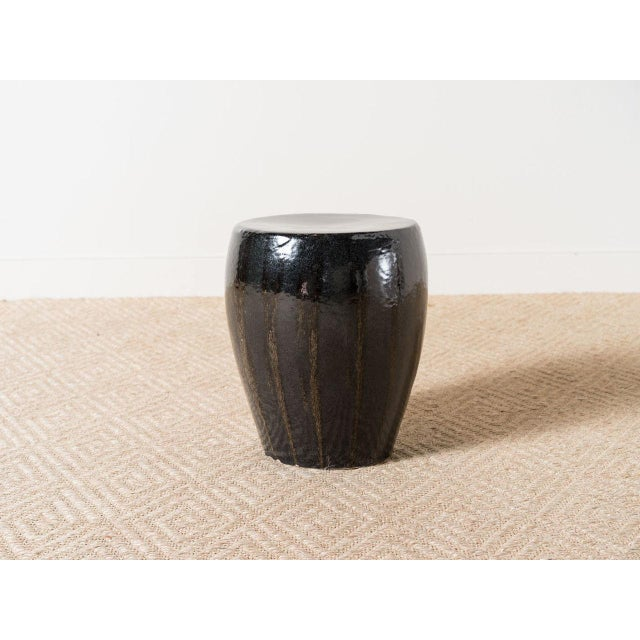 Earthenware stool / table with charcoal glaze and brown stripes. Made in the 2010s.