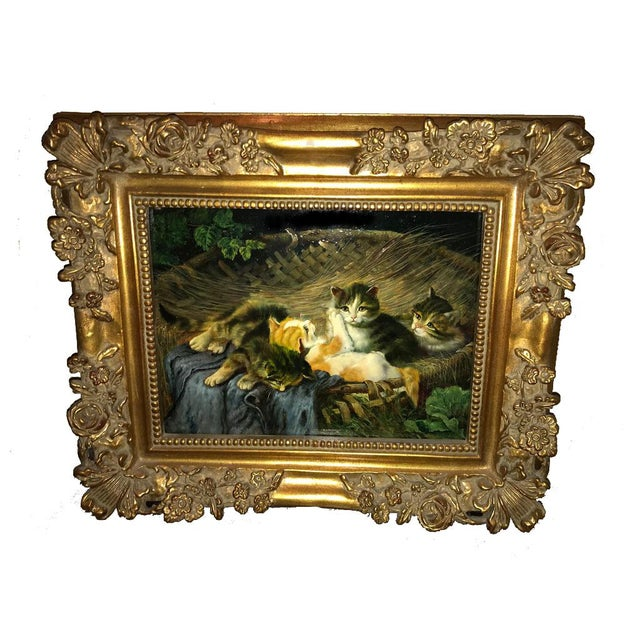 Charming painting of four kittens in a woven basket in wonderful, carved gilt wood frame