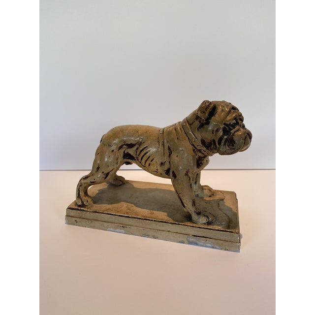 A Ceramic Bulldog Statue or could be a bookend Made in Japan signed on bottom by J. Daniel (could have been previous...