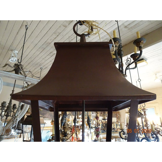 New French iron lantern in a dark burgundy color. 4 sides open lantern, no glass panels. 4 lights cluster. US wired. We do...