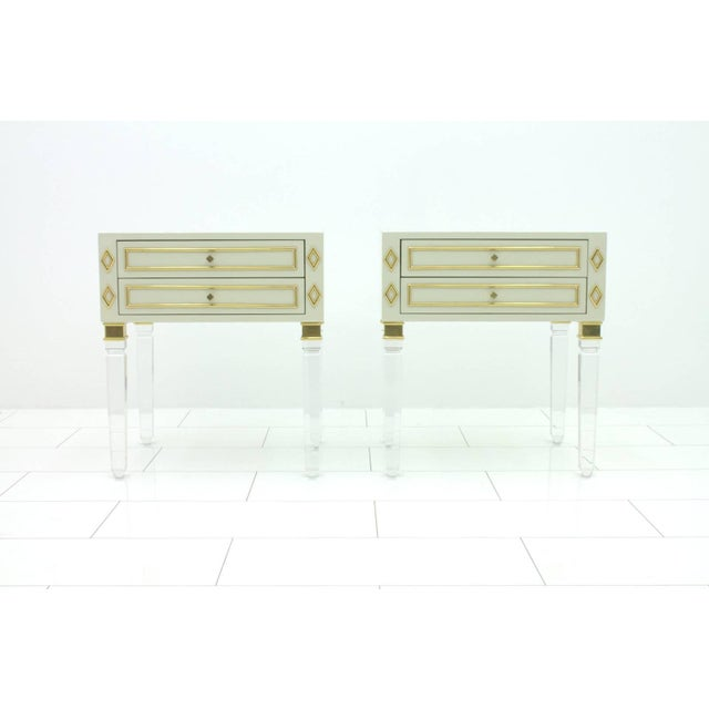 Pair of Nightstands in Lucite, wood and brass, 1970s. Very good condition. Worldwide shipping.