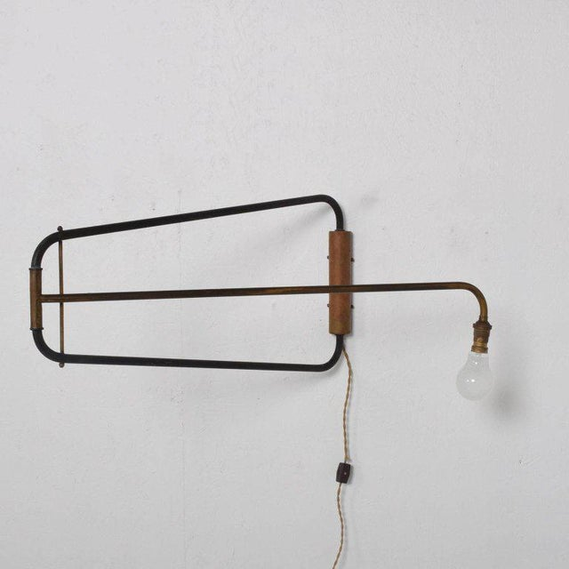 For your consideration a vintage wall sconce after Jean Prouve. France, circa 1950s. Bayonet bulb exposed. Rewired.