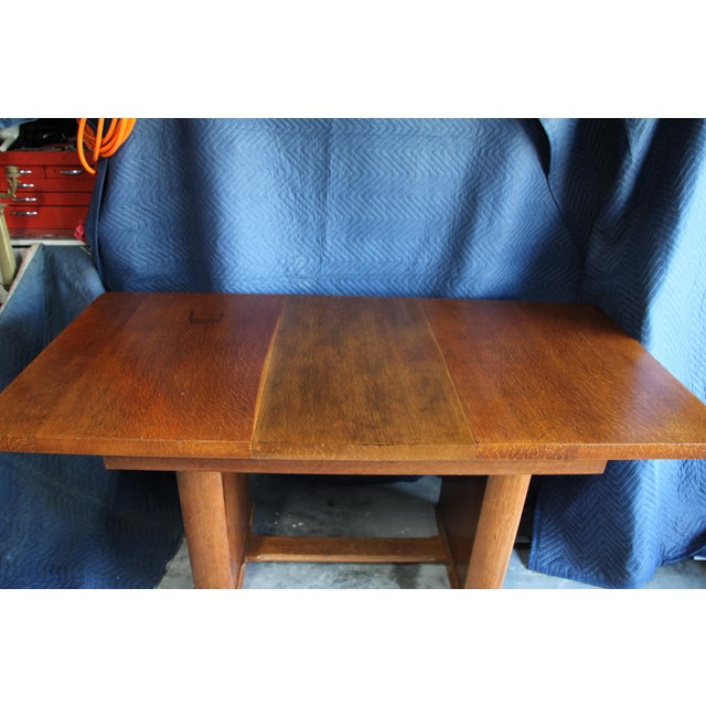 Iconic Art Deco Rift cut Oak dining table with extension. This table was handmade in 1920 in the United States. It is all...