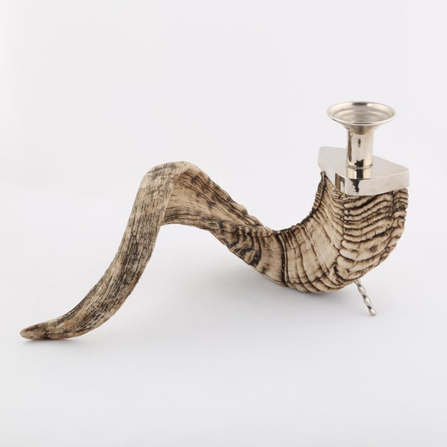 Rough and curved ram's horn candle holder with polished-nickel fittings, including triangular-base candle holder and...