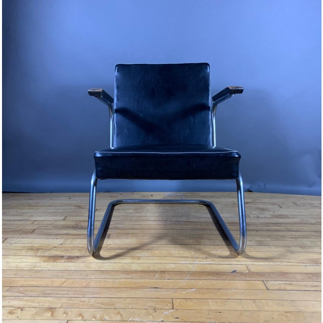 With influences from Bauhaus Deutsche Moderne - this 1950s cantilever armchair is all original by Drabert Germany. The...