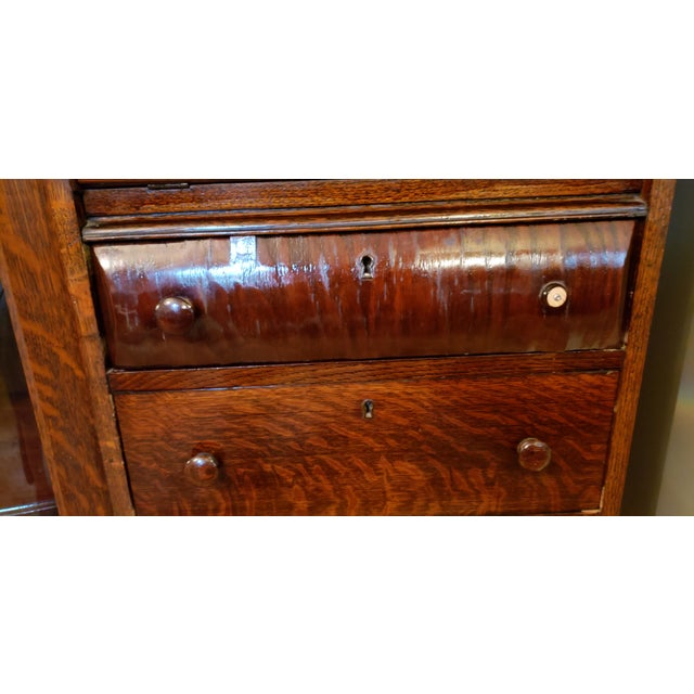 This is a beautiful turn of the 19th/20th century quarter-sawn oak secretary desk with display or book cabinet with...