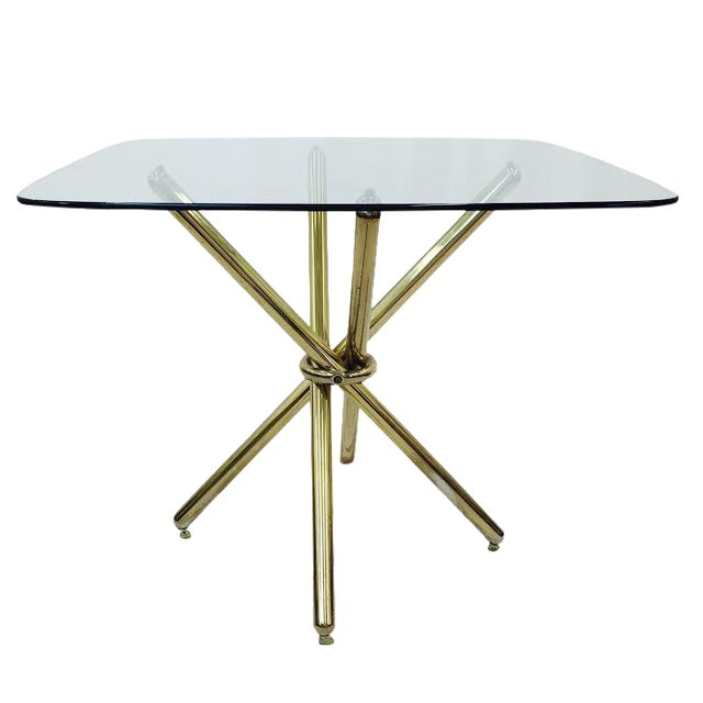 Mid-Century Modern Brass Knot Glass Top Table For Sale