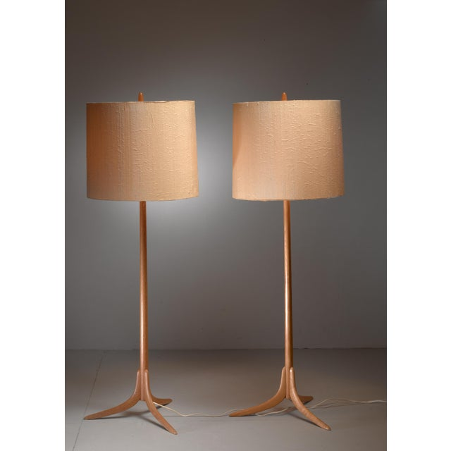 A pair of Swedish floor lamps with three feet in oak. The lamps have two light bulbs with a pull cord switch. We have a...