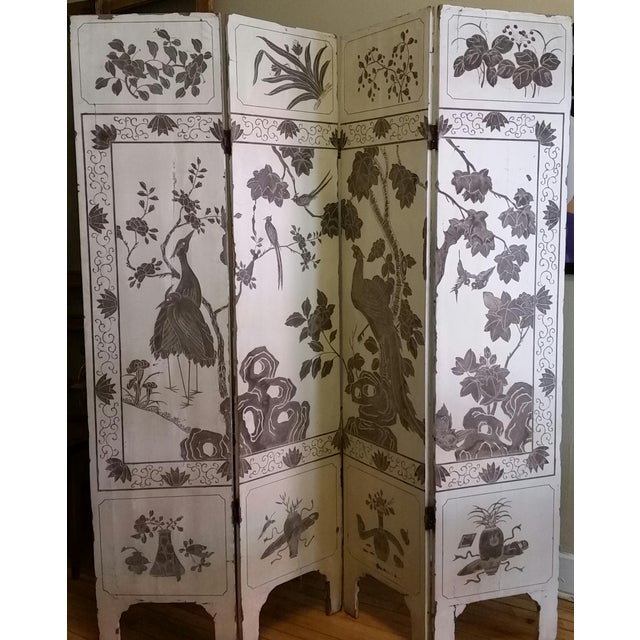 This four panel folding screen or room divider was made in China in the 1920s before the Communist takeover when luxury...