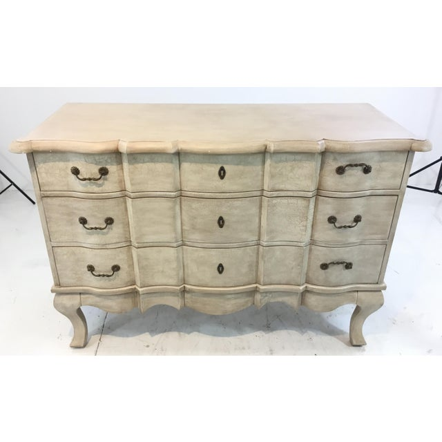 Stylish Currey & Co. transitional French style white washed wood chest of drawers, three drawers, showroom floor sample