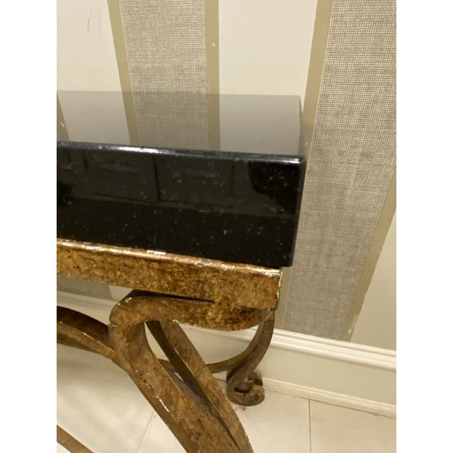"""Granite 2"""" thick sits atop a scrolled bronze frame. Neoclassical details add elegance to this statement piece. Use in your..."""