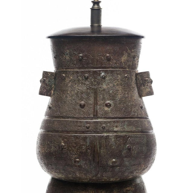 Inspired by ritualistic wine vessels from the Shang Dynasty with intricate ancient motifs, the Hogo Lamp blends tradition...