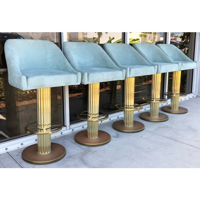 Fantastic set of 5 high end Design For Leisure solid brass bar stools. Brass bases show patina and fabric has few small...