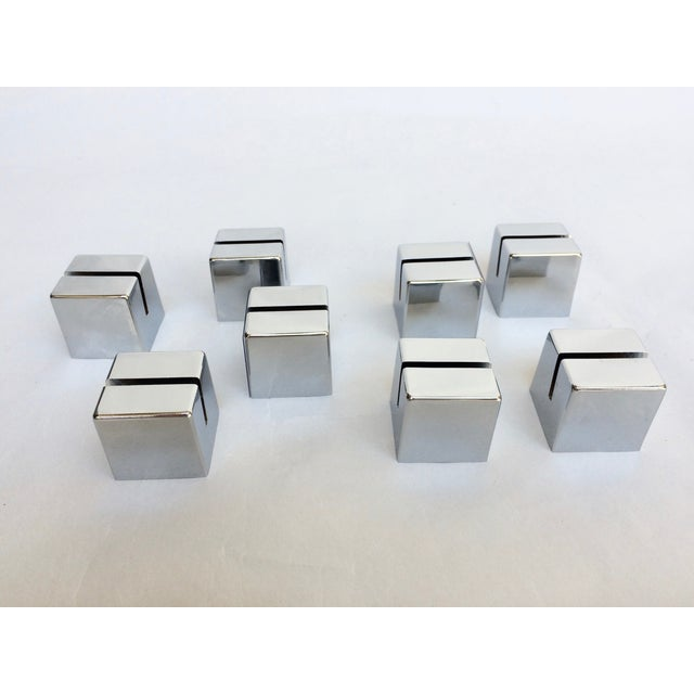 Set of 8 chrome cube place card holders. Nice weight and heft, angled slot for place card, menu item description, or...