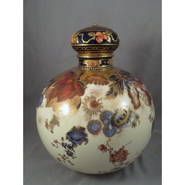 For your consideration is this rare and beautiful Royal Crown Derby gilt porcelain covered jar from 1889. The lidded jar...