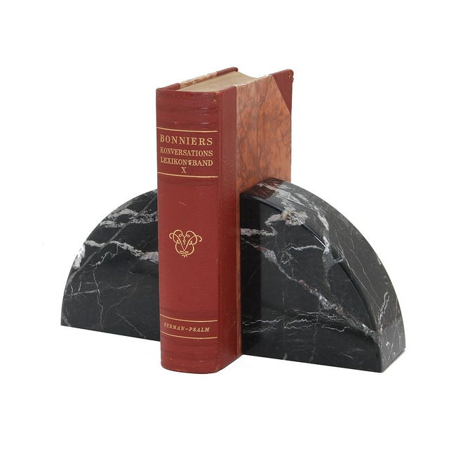 A pair of Cerasus Collection Black Zebra Marble Bookends.