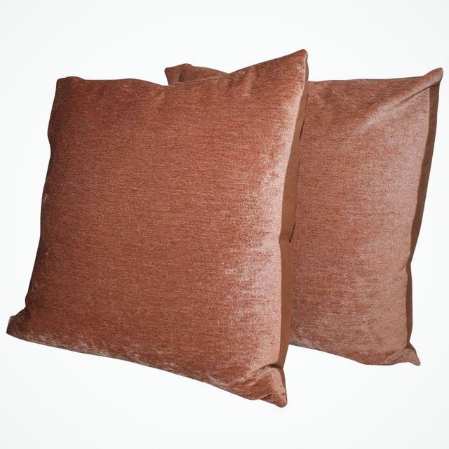 This pair of vibrant peach colored pillows are amazing. These pillows are down and feather insert with cotton linen...