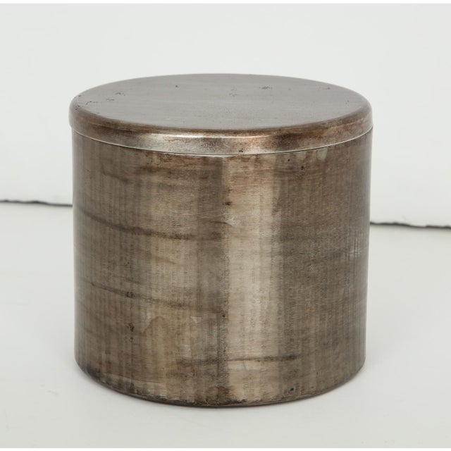 Hand-built canister of hammered, shaped, and welded steel, with cork inner lid, by Greek-born, Paris-based sculptor...