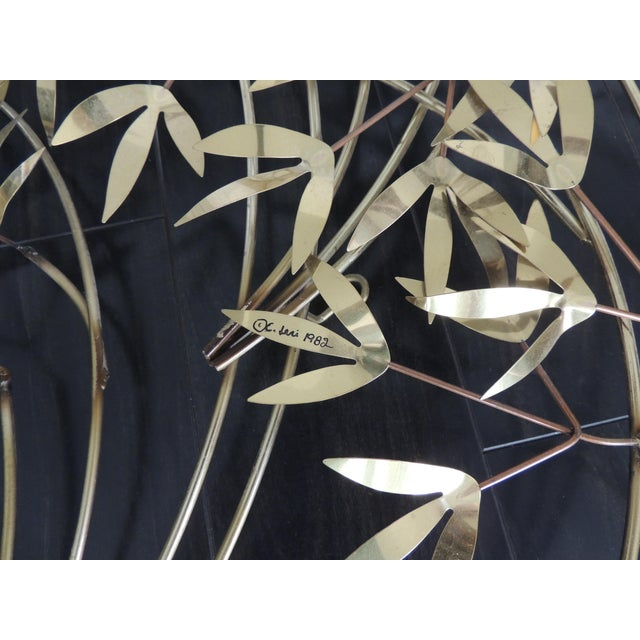 An original C. Jere (Curtis Freiler and Jerry Fels) wall metal sculpture of layered bamboo leaves, signed and dated 1982....