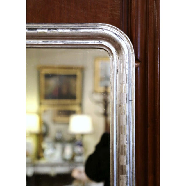 Crafted in the burgundy region of France, circa 1870, the antique mirror has traditional, timeless lines with rounded...