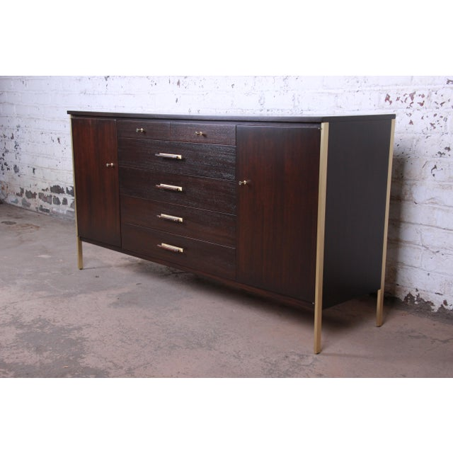 An exceptional mid-century modern sideboard or credenza designed by Paul McCobb for Calvin Furniture. The credenza...