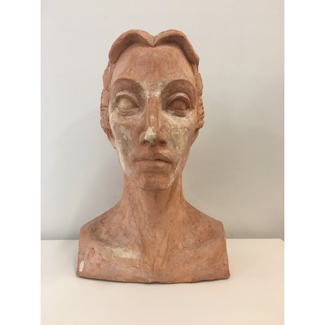 Substantial and beautiful female bust. This piece looks to be artisan made. The interesting mix of color and texture makes...