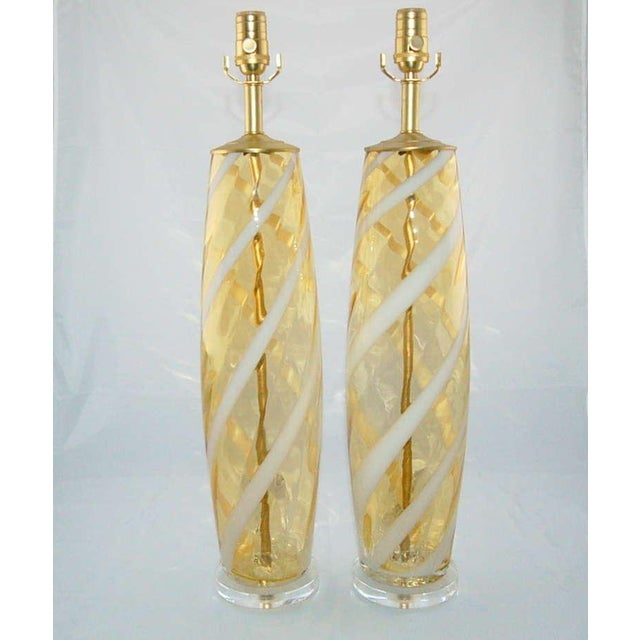 Vintage Italian glass table lamps of LEMON HONEY with a ribbon of WHITE swirling up and around. We have them paired with...
