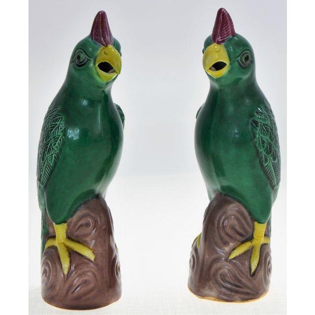 Offering a delightful vintage pair of small Chinese porcelain pair of parrots, circa 1970s. These parrot sculptures or...