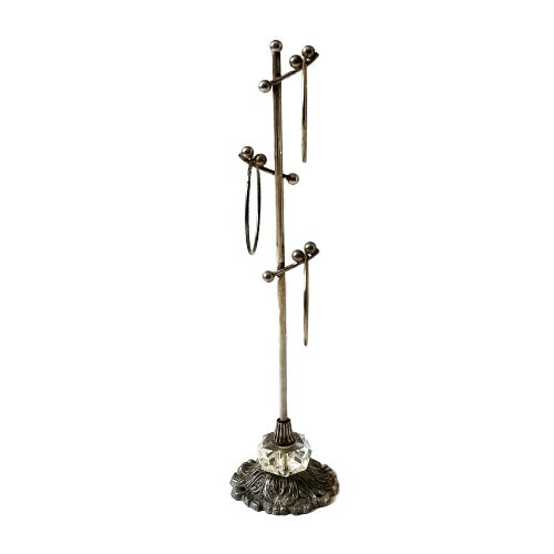 This is a vintage mid century ornate metal stand that has three rings to display items from, perfect size for vintage...