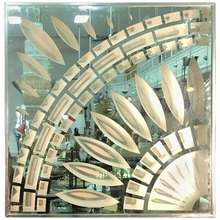 EXCEPTIONAL CHROME AND GLASS WALL MIRROR WITH UNUSUAL DESIGN BY GREG COPELAND For Sale