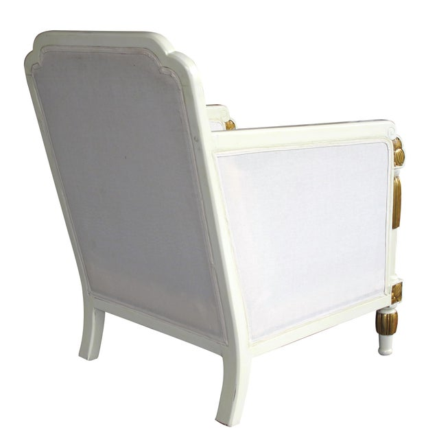 Each with scalloped back above a loose cushion seat flanked by cascading waterfall arms adorned with gilt cloud and...