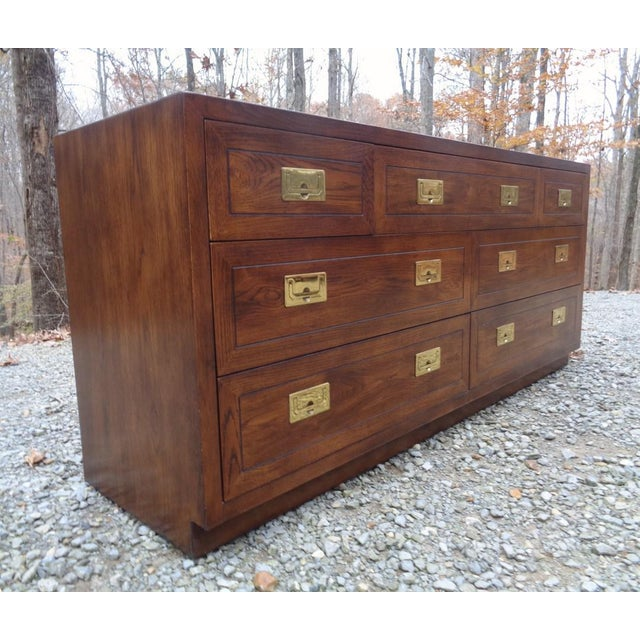 Gorgeous vintage c. 1985 Henredon campaign lowboy dresser/chest of drawers. Dark oak with brass pulls. All is original and...