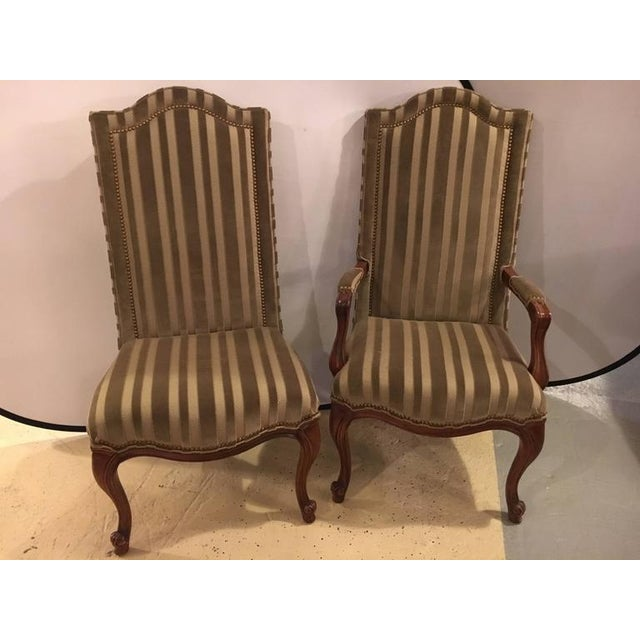 Set of ten harden dining room chairs. Two armchairs and eight side chairs. Each in a clean and lovely stripped green...