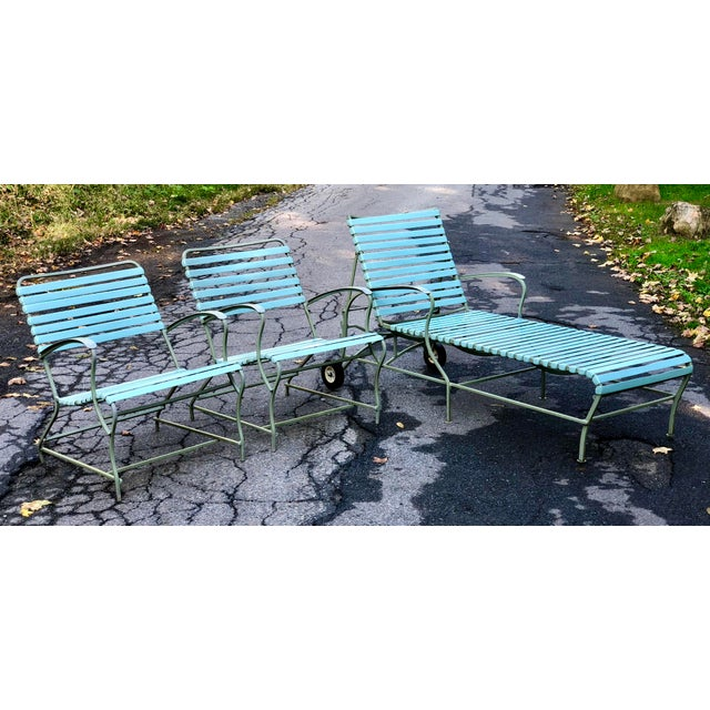 Very curvy low-slung mid century set in perfect poolside color combo. Aluminum frames are a muted sea foam green. Vinyl...
