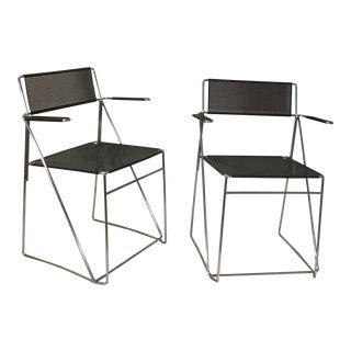 1970's Italian Black Metal & Chrome Mesh Stacking Chairs With Arms - a Pair For Sale