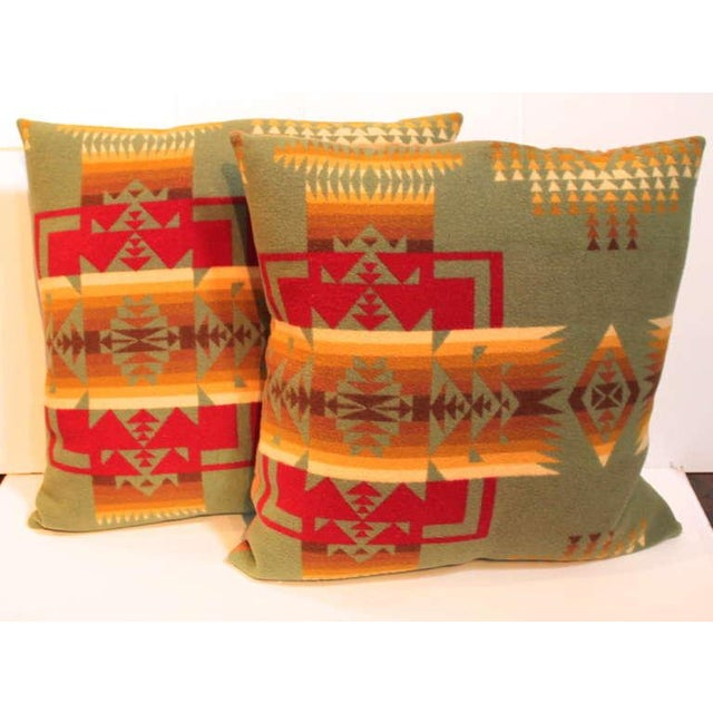 This pair of fantastic Indian design blanket pillows were cut from a mid century Pendleton camp blanket. This pair has a...