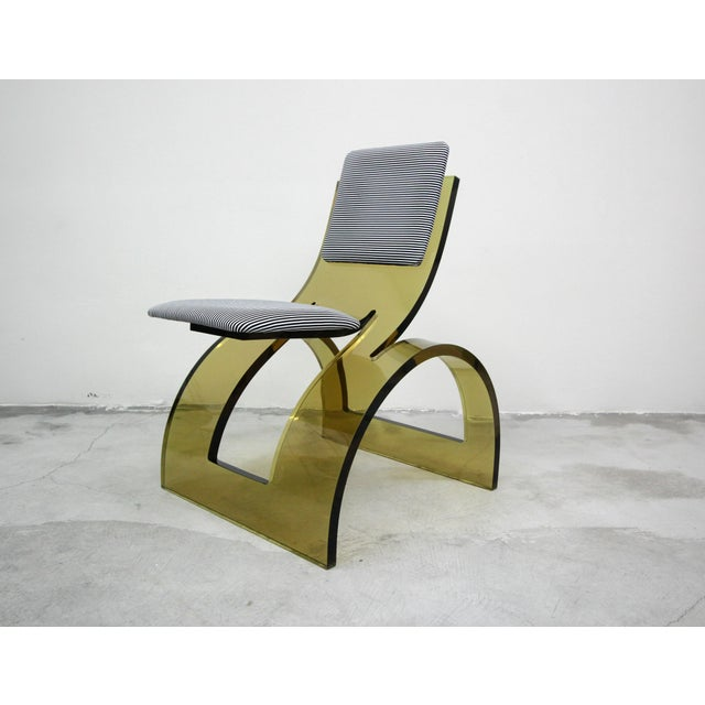 A work of art, a true perfect one off. This RARE Sculptural Cantilevered Vintage Arched Colored Lucite Corner Lounge Chair...