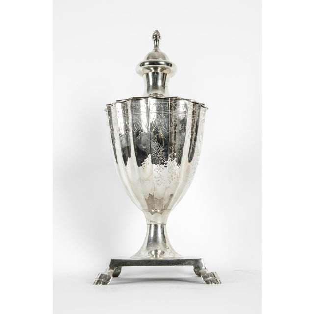 Late 20th century North American silver plated covered dish. urn with exterior design details and claw feet. The dish is...
