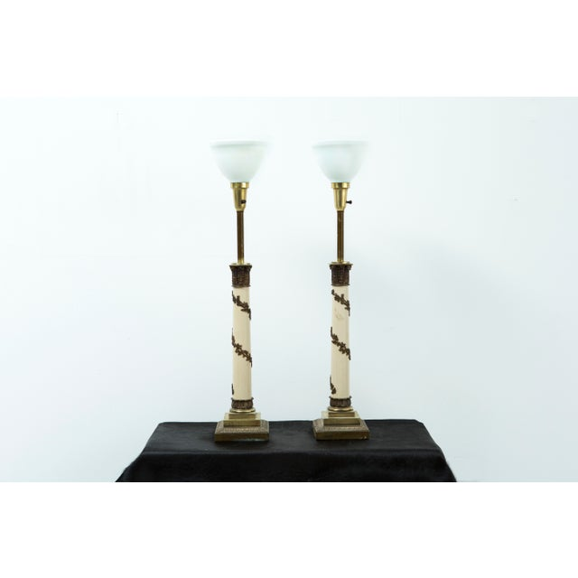 A set of two Hollywood Regency lamps by Stiffel made in the USA, circa 1960s. This piece is brass. Sold as a set.