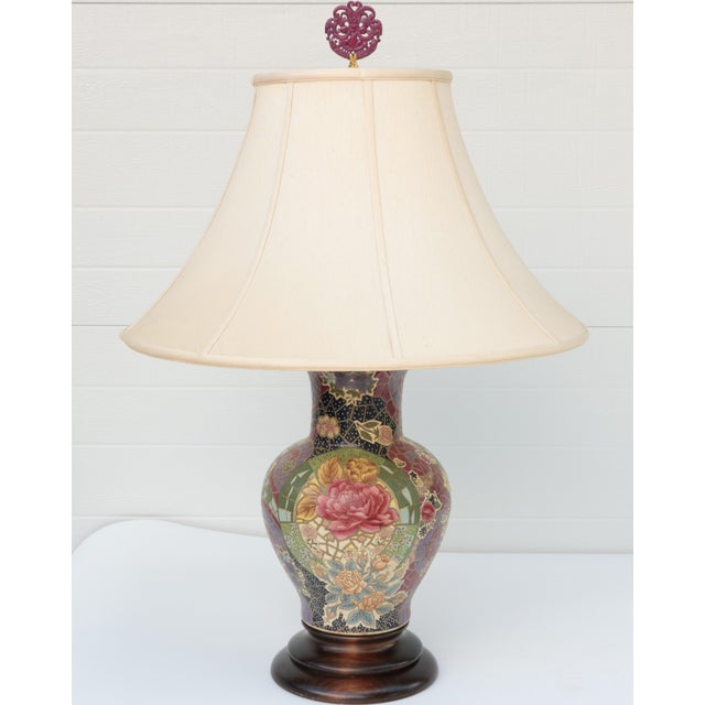 Pair of colorful chinoiserie ceramic lamps on wooden bases by Frederick Cooper, Chicago, IL. Original wiring in working...