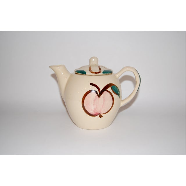 Cute, small, vintage hand-painted teapot (from either the 1950's or 1960's). One side has a painted pear and the other has...