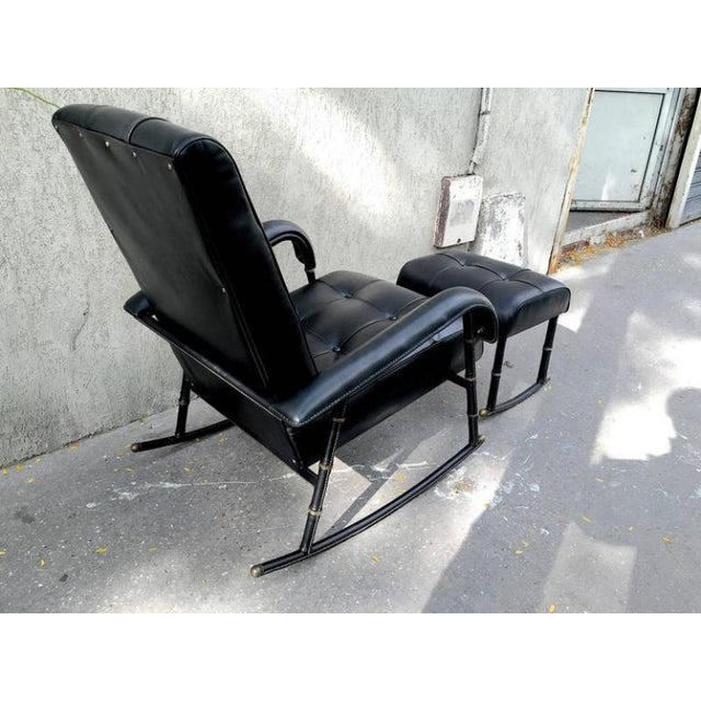 Jacques Adnet rare rocking chair and footstool in black hand-stitched leather.