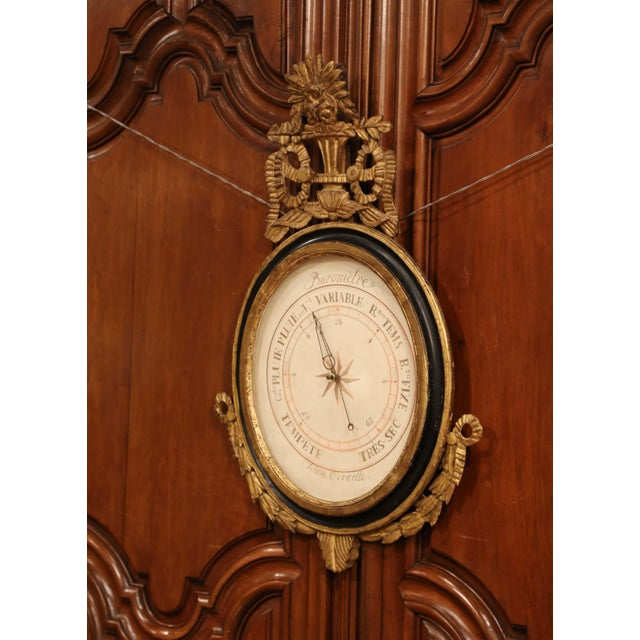 This elegant, antique Louis XVI barometer was crafted in Paris, France, circa 1760. The large oval shaped wall piece...