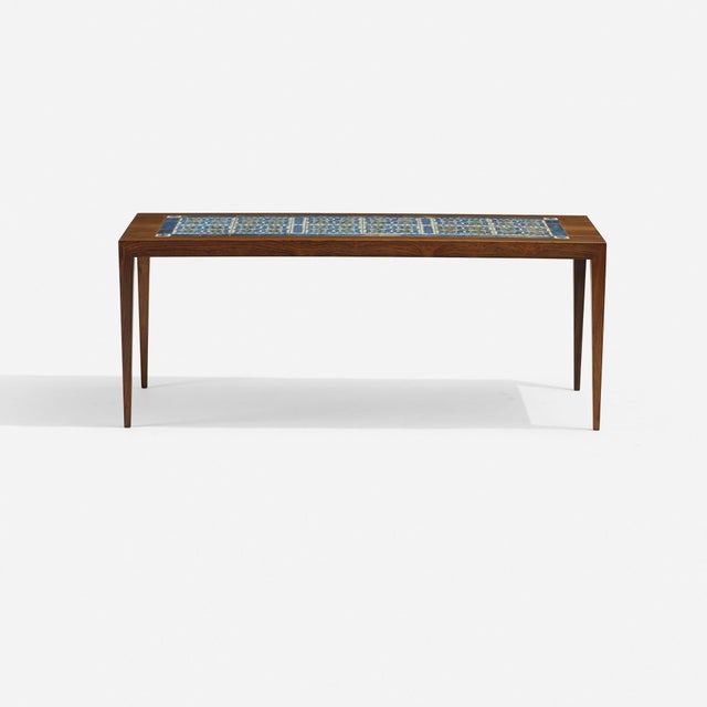 A beautifully crafted rosewood coffee table by Severin Hansen, inlaid with variegated olive green and sea blue glazed...