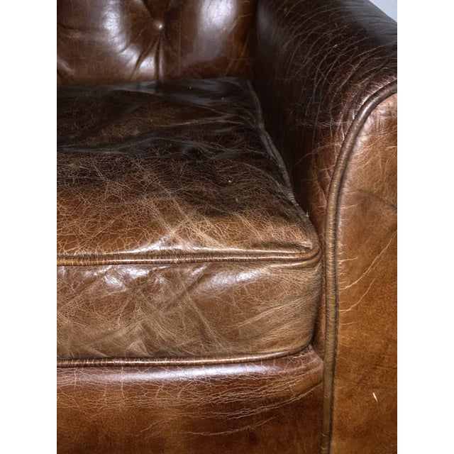 Beautiful high quality leather wingback. Leather is a tobacco/ dark chocolate color. Down-filled cushion is removable.