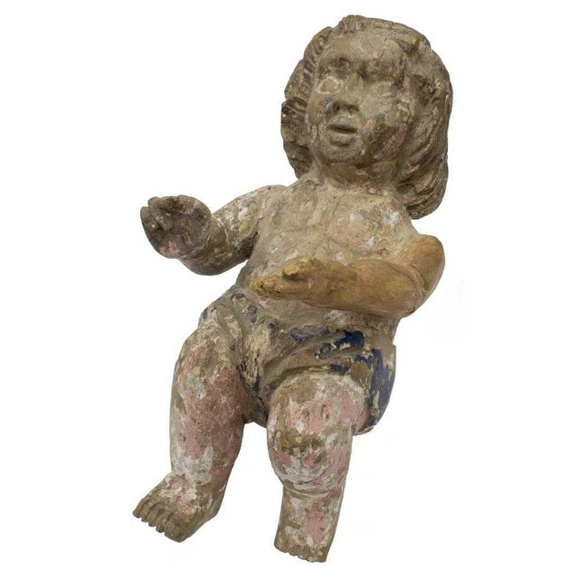 This is a wonderful European (possibly Italian) carved wood putto figure from the early 19th c. Remnants of a painted...