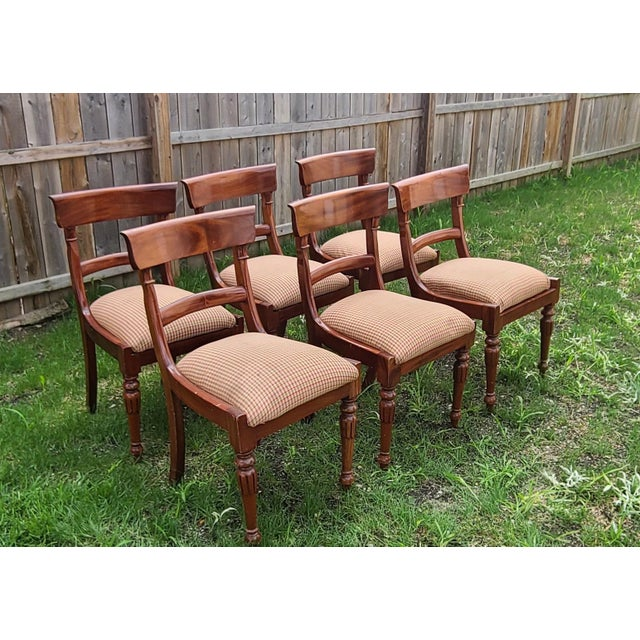 This is a very nice set of 6 reproduction mahogany Empire style dining room chairs. We sold these chairs new back in the...